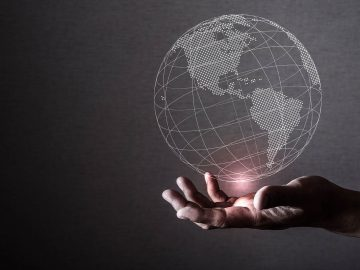 business person holding a globe